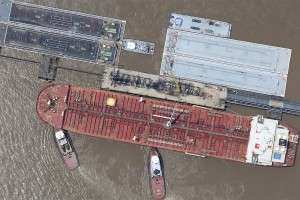 Ship and tugs on the Mississippi River aerial photo